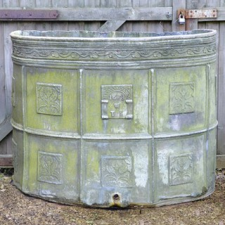 A semi-circular lead cistern Dated 1653