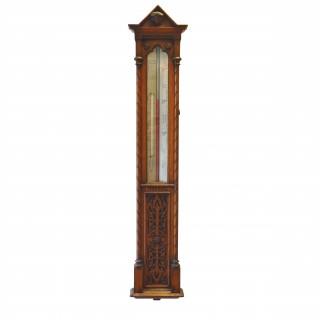 Oak cased Long Range wall barometer by Negretti and Zambra