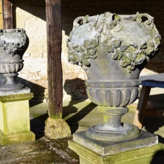 A fine pair of early 20th century lead garden urns