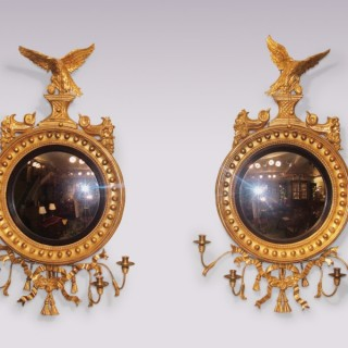 Pair of Regency period carved giltwood Convex Mirrors.