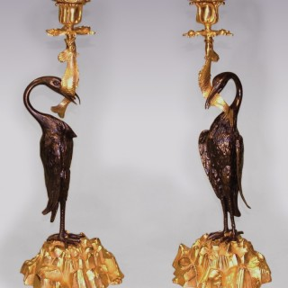 A Pair of mid 19th Century Bronze & Ormolu Candlesticks