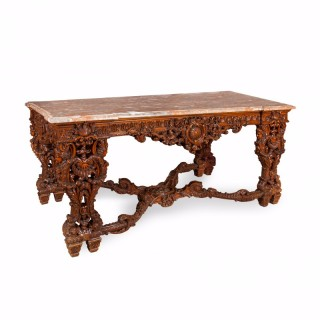 A large Regence style mahogany centre table with marble top