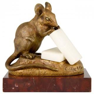 Antique bronze sculpture of a mouse eating sugar.