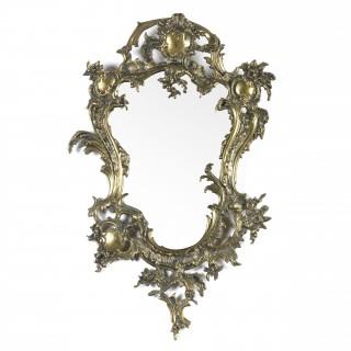 A Rococo style ormolu framed mirror