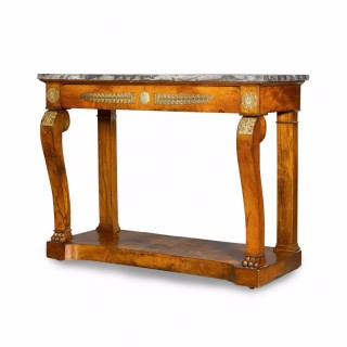 An Empire period ormolu mounted mahogany console table