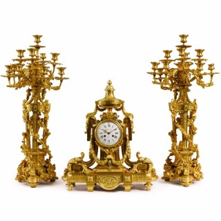 A large Louis XVI style ormolu clock set by F. Barbedienne