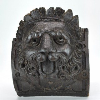 17th century carving of a crowned lion.