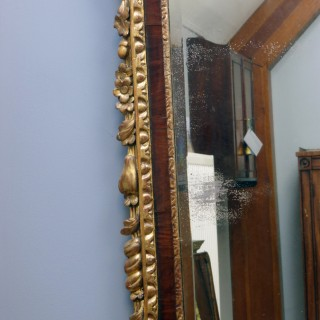 Rare and Impressive George II walnut and parcel gilt pier mirror