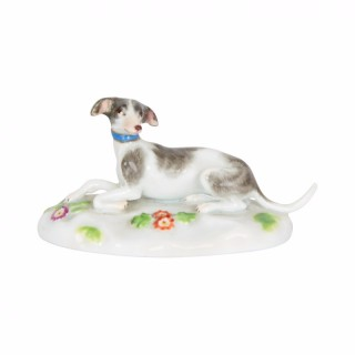 A Meissen porcelain figure of a resting dog