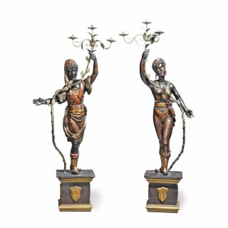 A pair of Baroque style wooden blackamoors as candelabra