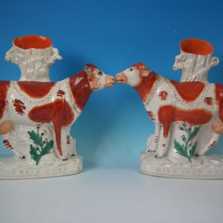 Pair Staffordshire 'Milk Sold Here' cow spill vases
