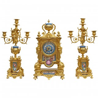 A Sevres style porcelain mounted ormolu three piece clock set