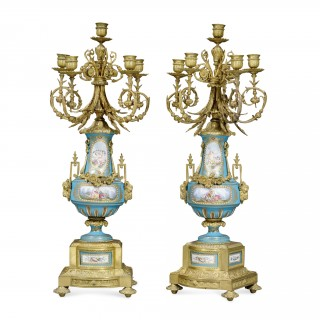 A pair of five branch ormolu and Sevres style porcelain candelabra