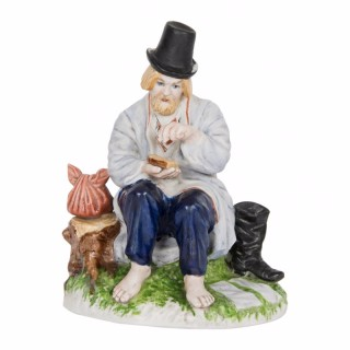 A Gardner factory bisque porcelain figure of a peasant