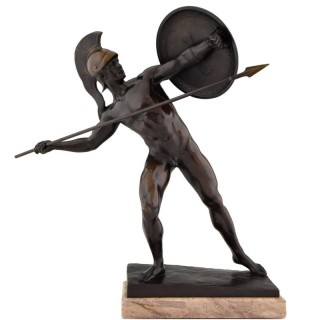Antique bronze male nude warrior with shield.