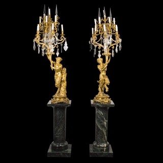 A large pair of ormolu and cut glass candelabra