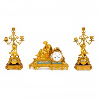 A Sèvres style porcelain mounted ormolu three piece clock set by Raingo Frères