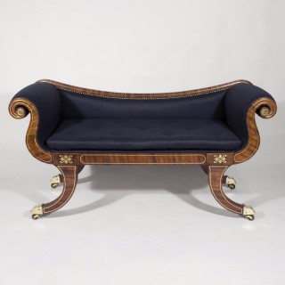 A Regency Period Mahogany and Brass Inlaid Sabre Legged Window Seat