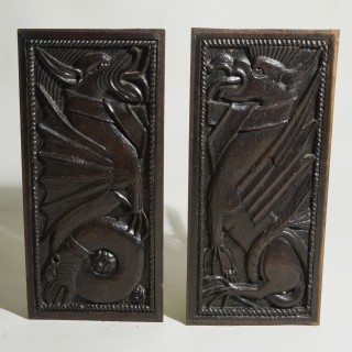 A Pair of Late 16th Century Relief Carved Panels of Mythical Beasts
