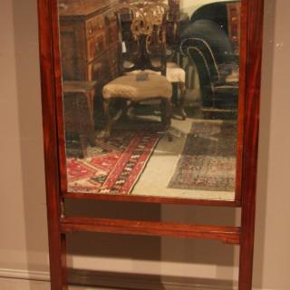 An elegant Regency period mahogany Cheval mirror