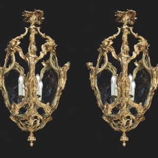 A Pair of Antique Lanterns in the Louis XV Manner