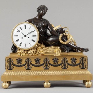 An Antique French Mantle Clock in the Louis XVI Manner