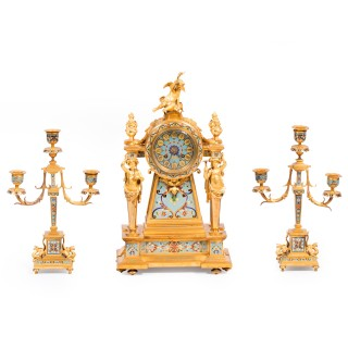 A fine ormolu and cloisonne enamel three piece clock set