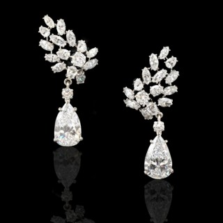 An Important And Striking Pair Of Pear Shaped Diamond Drop Earrings By Cartier, c.1950's