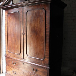 A Handsome Architectural George III Mahogany Linen Press Later Adapted to a Wardrobe c.1780