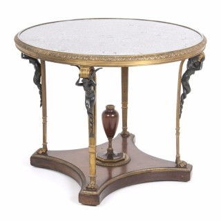 A gilt and patinated bronze mounted centre table by Zwiener Jansen Successeur