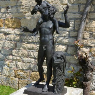 A Neapolitan verdigris bronze model of a young Satyr with the infant Dionysus