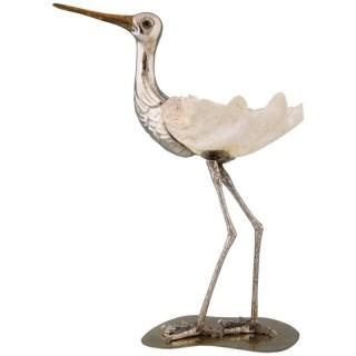 Modern sculpture of a bird silvered metal and seashell