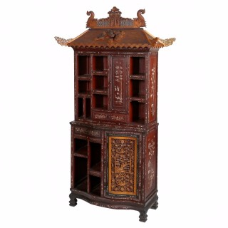 An unusual bone inlaid carved hardwood, boxwood and ebony cabinet