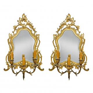 A pair of Louis XV style ormolu mirrored wall lights