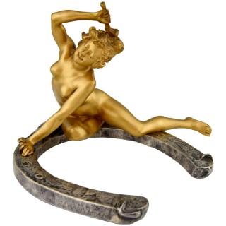 Art Nouveau bronze nude on a horseshoe