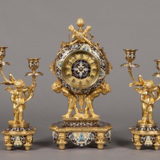 An Antique French Mantle Clock Garniture in the Louis XVI Manner