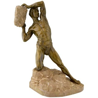 Antique bronze sculpture male nude with rock.