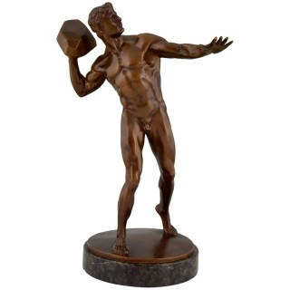 Antique bronze sculpture male nude throwing stone