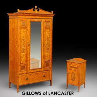 A Gillows of Lancaster Satinwood Wardrobe and Bedside Cabinet