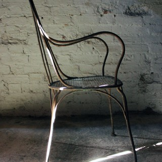 A Sculptural Early 20thC French Metal Garden Open Armchair