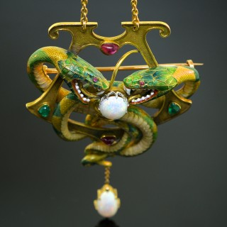 An enamel, opal, emerald and ruby serpent pendant