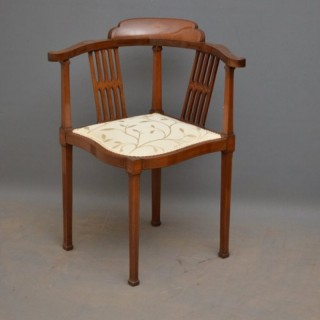An Edwardian Mahogany Corner Chair