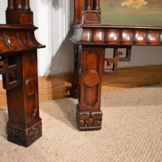 A superb decorative pair of Chinese Chippendale open bookcases in the George III manner