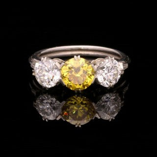 An Elegant Yellow And White Diamond Three  Stone Platinum Ring By Hancocks