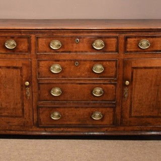A Large George III Oak Dresser Base Cross-Banded in Mahogany