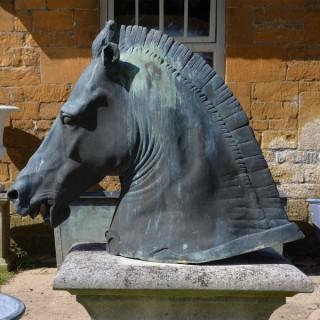 A verdigris cast bronze copy of the Roman horse head known as the 'Medici Riccardi Horse'