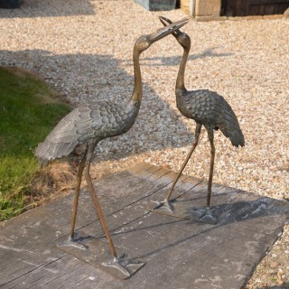 A pair of small scale Japanese bronze cranes