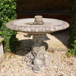 A composition stone fountain base by Austin and Seeley