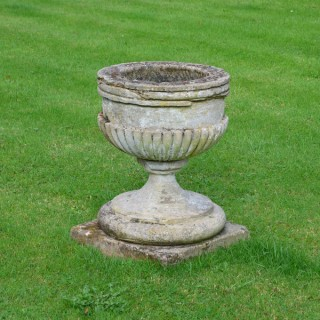 An 18th century carved stone urn