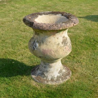 A large-scale single sand stone urn of bulbous form